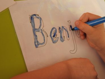When should I teach my child to write their name?