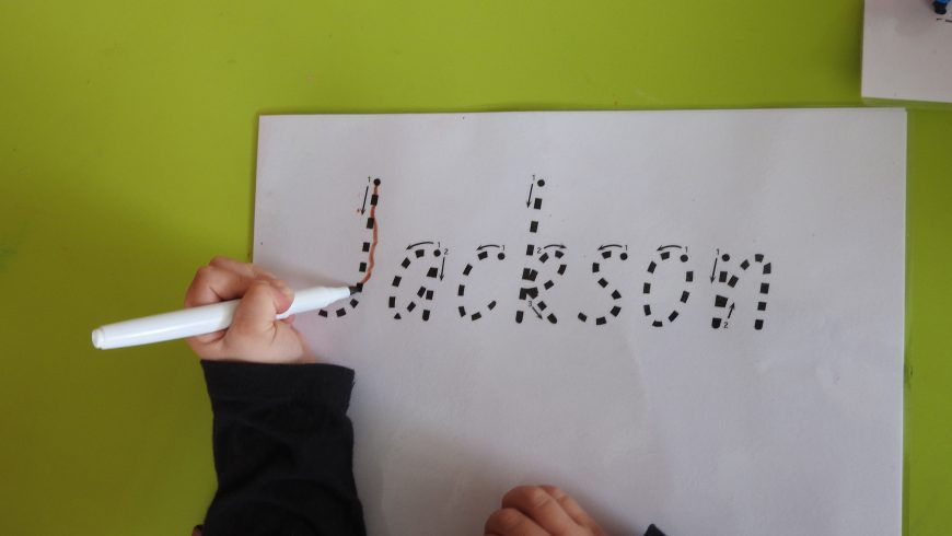 How do I teach my child to write their name?
